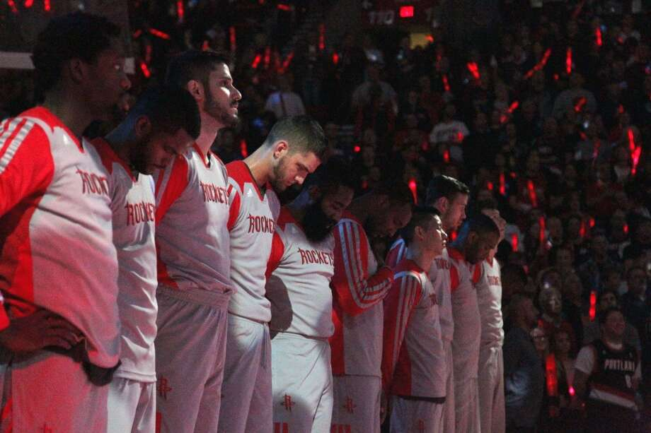 The Rockets stand in line before the first quarter of Game 4 of the Western Conference Quarterfinals against the Portland Trail Blazers. Photo: James Nielsen, Houston Chronicle