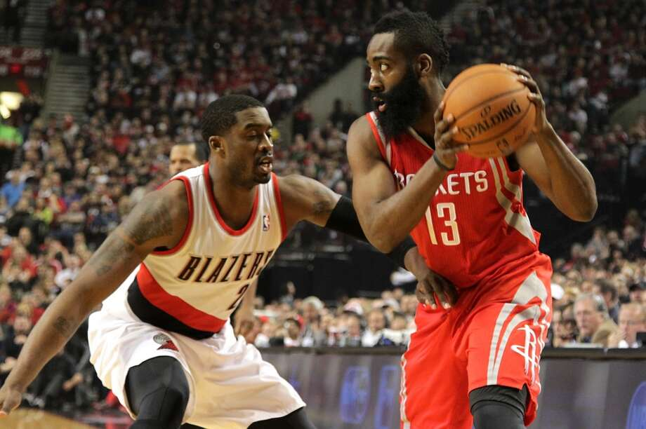 Portland Trail Blazers guard Wesley Matthews defends James Harden. Photo: James Nielsen, Houston Chronicle