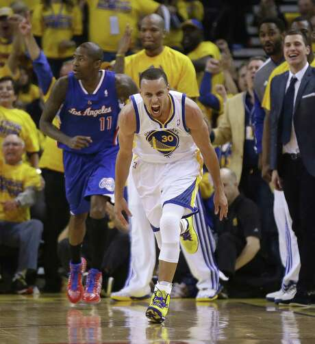 Golden State guard Stephen Curry reacts after one of his playoff career-high seven 3-pointers. Curry scored 33, helping the Warriors tie the Clippers 2-2. Photo: Marcio Jose Sanchez / Associated Press / AP