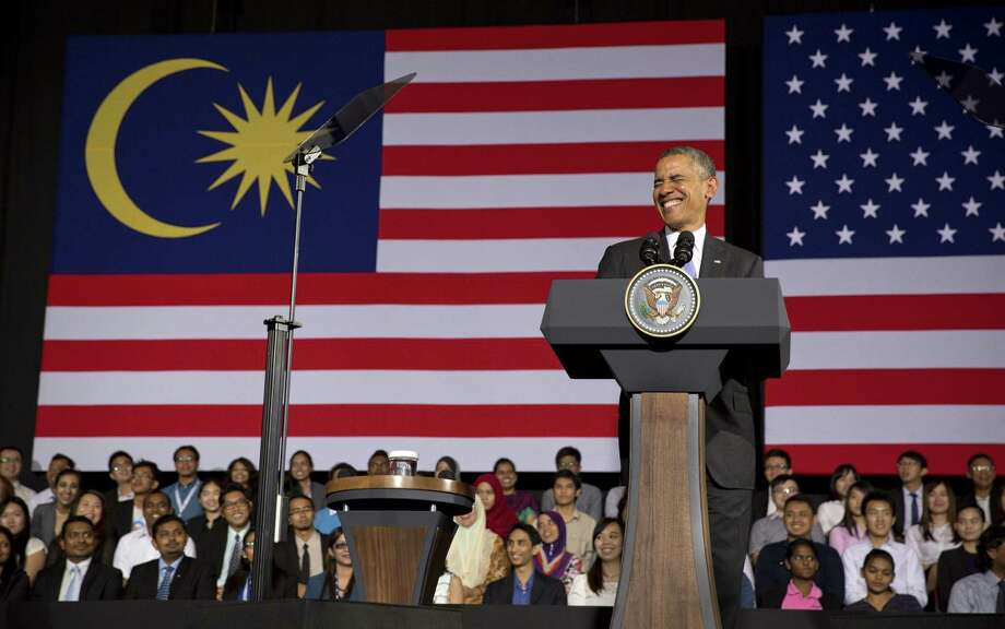 President Barack Obama answers questions from youth leaders in Kuala Lumpur, Malaysia, part of his week-long trip to Asia. Photo: Stephen Crowley / New York Times / NYTNS