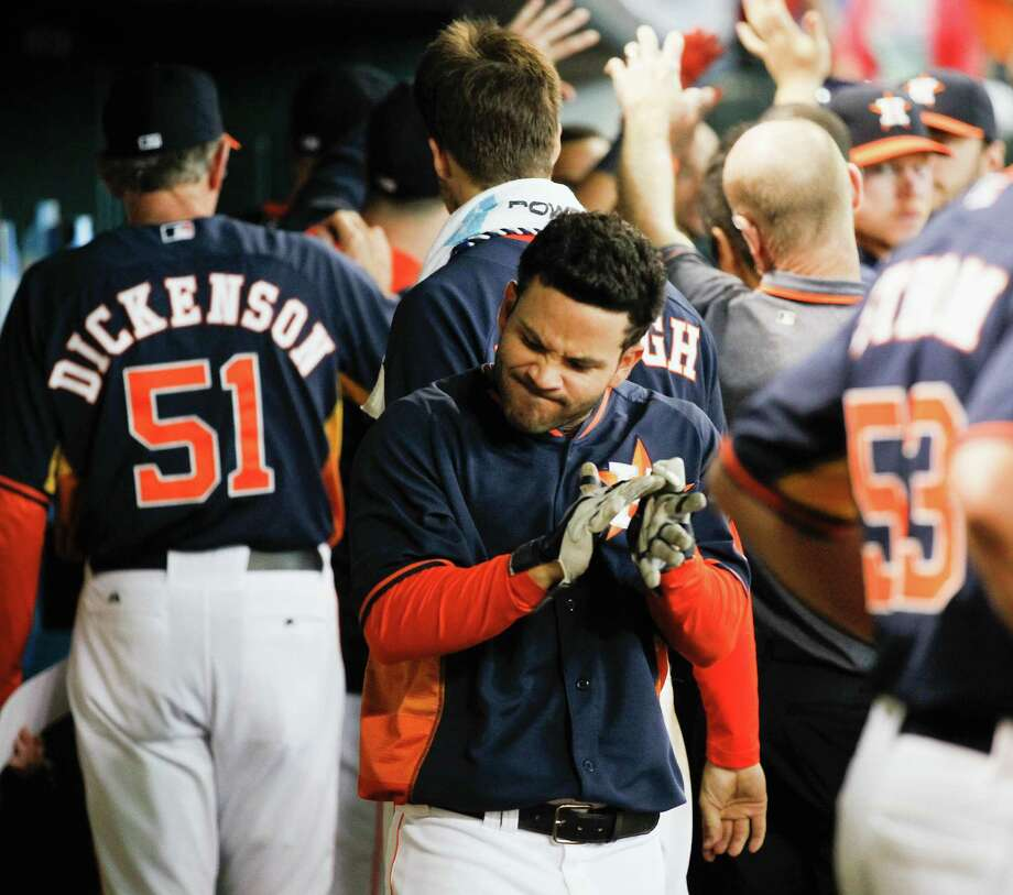 Jose Altuve of the Astros celebrates after his seventh-inning homer against the A's. The blast supported the 82/3 innings of strong pitching by Collin McHugh. Photo: Bob Levey / Getty Images / 2014 Getty Images