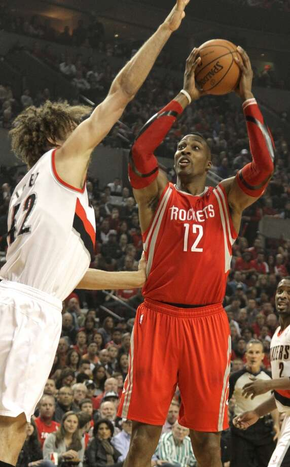 April 27 - Game 4: Blazers 123, Rockets 120 (OT)  Portland leads series: 3-1  Rockets center Dwight Howard shoots over Trail Blazers center Robin Lopez. Photo: James Nielsen, Houston Chronicle