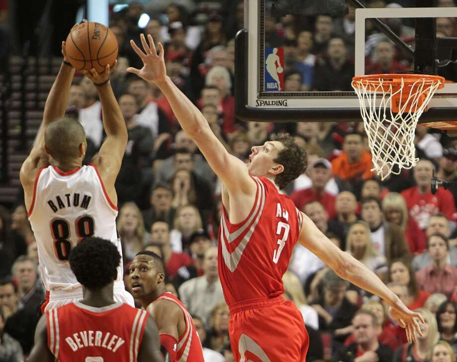 Trail Blazers forward Nicolas Batum shoots with over Rockets center Omer Asik. Photo: James Nielsen, Houston Chronicle