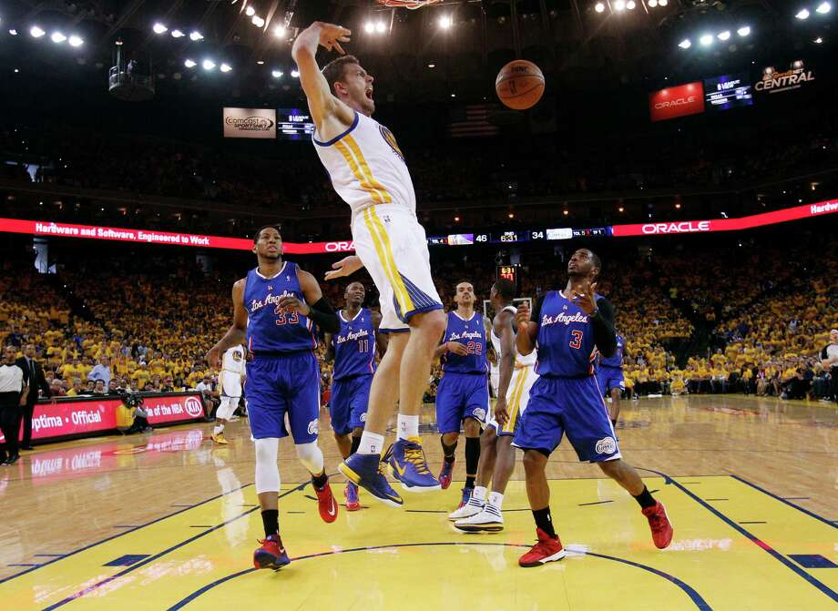 Golden State Warriors' David Lee, center, dunks next to Los Angeles Clippers' Danny Granger (33), and Chris Paul (3) during the first half in Game 4 of an opening-round NBA basketball playoff series on Sunday, April 27, 2014, in Oakland, Calif. (AP Photo/Marcio Jose Sanchez) Photo: Marcio Jose Sanchez, STF / AP
