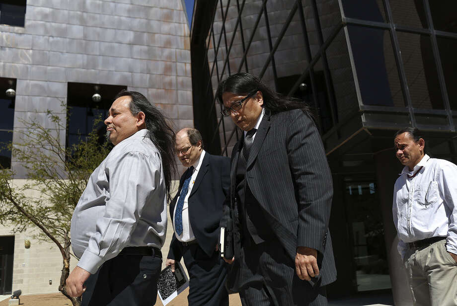 Tigua tribal council members David Gomez (left) and Rafael Gomez Jr. (right) leave a federal courthouse in El Paso with attorneys after a hearing on gaming. Photo: Photos By Lisa Krantz / San Antonio Express-News / SAN ANTONIO EXPRESS-NEWS