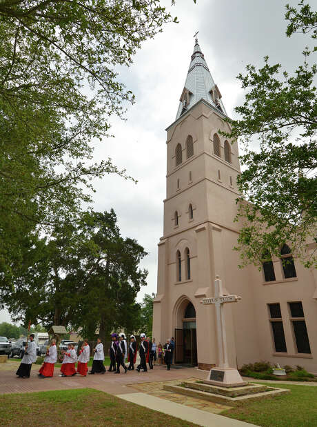 A procession leaves Annunciation of the Blessed Virgin Mary Catholic Church in St. Hedwig Sunday during services honoring the canonization of Pope John Paul II. Photo: For The San Antonio Express-News