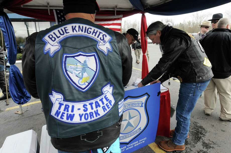 Members of the Blue Knights register before the start of the third annual memorial motorcycle ride, co-sponsored by Blue Friday of New York Chapter 24 and the Blue Knights on Sunday, April 27, 2014, in Schenectady, N.Y.  The ride was part of the Blue Friday events.  Blue Friday is a day that has been set aside by the state Legislature each year since 2005 to honor law enforcement officers who have been killed in the line of duty and also those who are still protecting and serving.   (Paul Buckowski / Times Union) Photo: Paul Buckowski / 00026621A