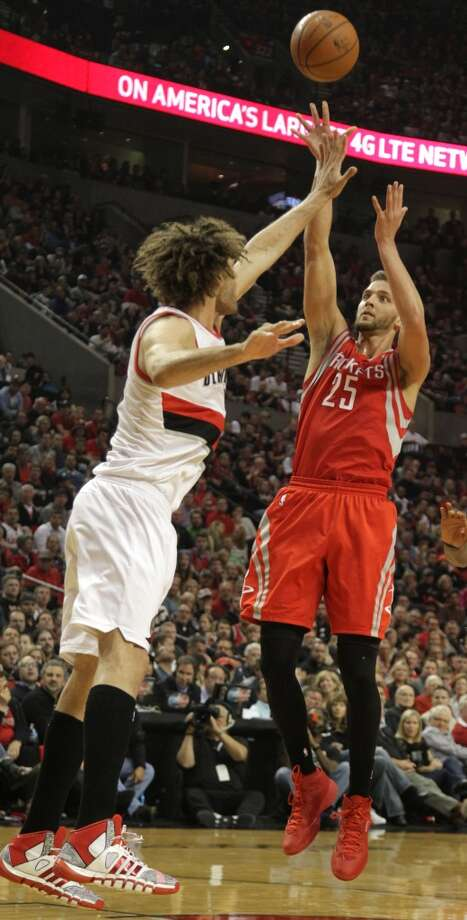 Rockets forward Chandler Parsons shoots over Trail Blazers center Robin Lopez. Photo: James Nielsen, Houston Chronicle
