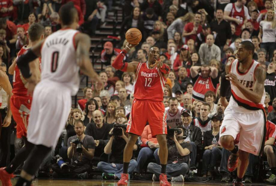 Rockets center Dwight Howard directs traffic after grabbing a redound. Photo: James Nielsen, Houston Chronicle