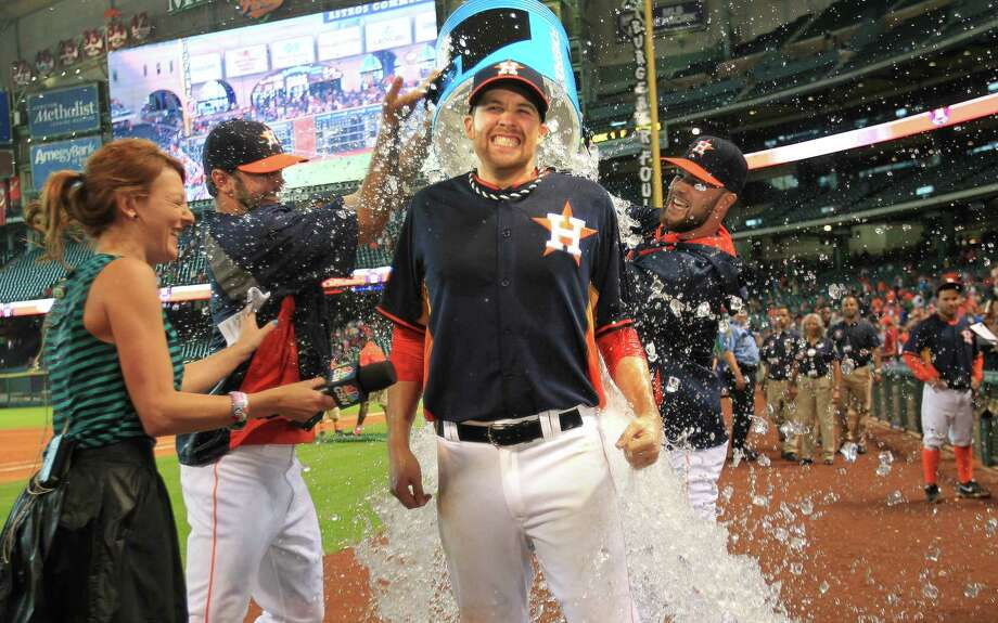 Astros starter Collin McHugh, off to a sizzling start in the majors, cools off courtesy of his teammates during a TV interview. Photo: Mayra Beltran, Staff / © 2014 Houston Chronicle