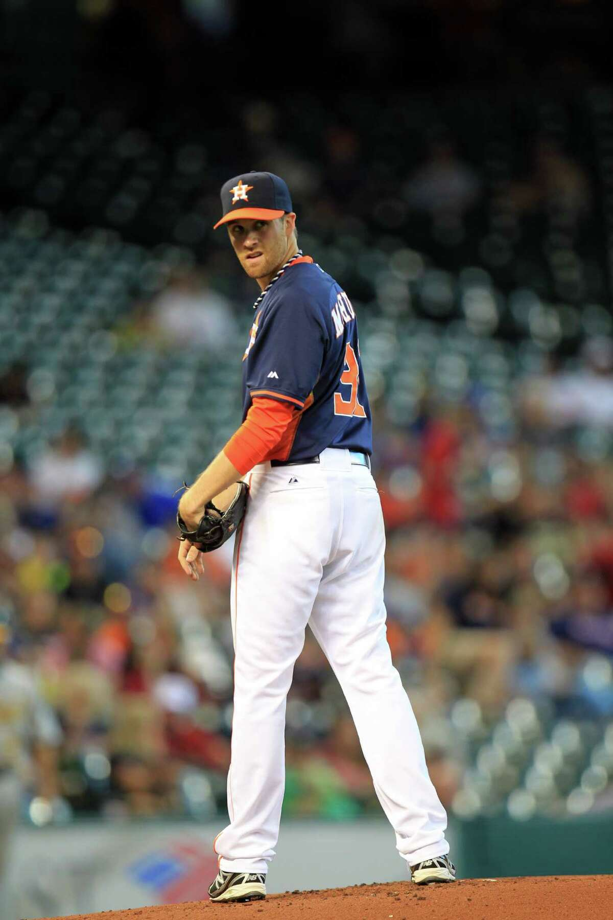 Astros starter Collin McHugh glances at the runner at first as he finds himself in a bases-loaded jam in the first inning. McHugh proceeded to retire 24 of the next 25 batters before running into trouble with two outs in the ninth inning.