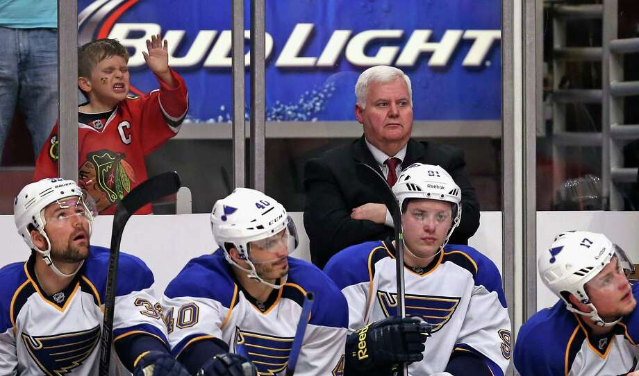 A young Blackhawks fan rubs it in as the final minutes of the season wind down for coach Ken Hitchcock and the Blues. Photo: Jonathan Daniel, Staff / 2014 Getty Images