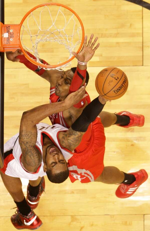 Portland Trail Blazers forward LaMarcus Aldridge, left, goes up for a shot against Houston Rockets center Dwight Howard during the first half of Game 4 of the Western Conference Quarterfinals playoffs at the Moda Center Sunday, April 27, 2014, in Portland. ( James Nielsen / Houston Chronicle ) Photo: James Nielsen, Houston Chronicle
