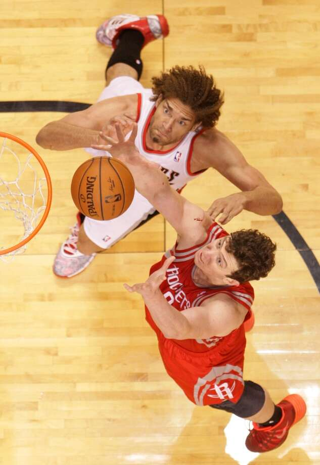 Houston Rockets center Omer Asik (3) and Portland Trail Blazers center Robin Lopez (42) go after a rebound during the first half of Game 4 of the Western Conference Quarterfinals playoffs at the Moda Center Sunday, April 27, 2014, in Portland. ( James Nielsen / Houston Chronicle ) Photo: James Nielsen, Houston Chronicle