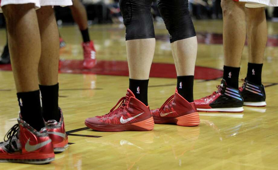 The Blazers and Rockets wore black socks during Game 4 of their playoff series as a show of solidarity with the Los Angeles Clippers, whose owner, Donald Sterling, is under fire for allegedly making racist comments. Photo: James Nielsen, Staff / © 2014  Houston Chronicle