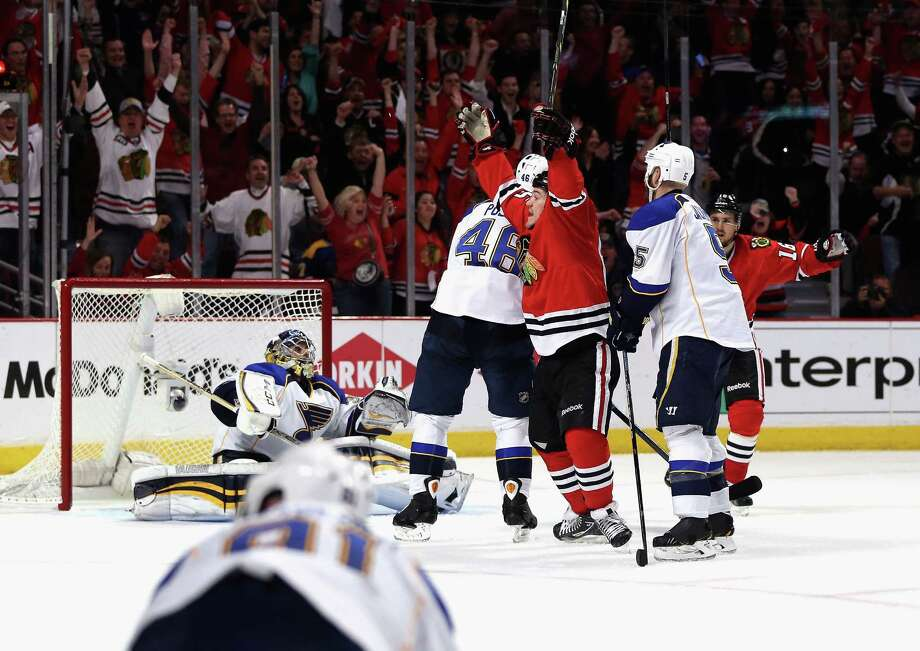 The Blackhawks' Andrew Shaw signals his third-period goal against Blues goaltender Ryan Miller during Game 6 in Chicago. The defending Stanley Cup champions won four straight. Photo: Jonathan Daniel / Getty Images / 2014 Getty Images