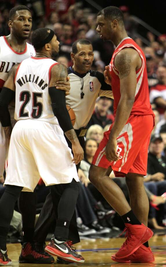 Portland Trail Blazers guard Mo Williams (25) and Houston Rockets forward Terrence Jones are separated by an official during the third quarter of Game 4 of the Western Conference Quarterfinals playoffs at the Moda Center Sunday, April 27, 2014, in Portland. ( James Nielsen / Houston Chronicle ) Photo: James Nielsen, Houston Chronicle