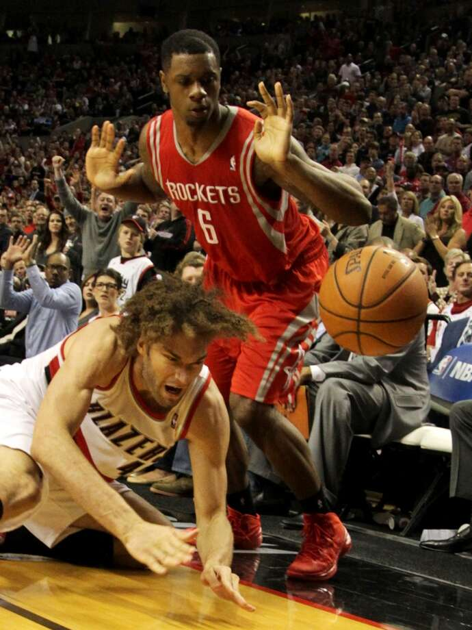 Portland Trail Blazers center Robin Lopez, left, and Houston Rockets forward Terrence Jones (6) go after a loose ball during the fourth quarter of Game 4 of the Western Conference Quarterfinals playoffs at the Moda Center Sunday, April 27, 2014, in Portland. ( James Nielsen / Houston Chronicle ) Photo: James Nielsen, Houston Chronicle