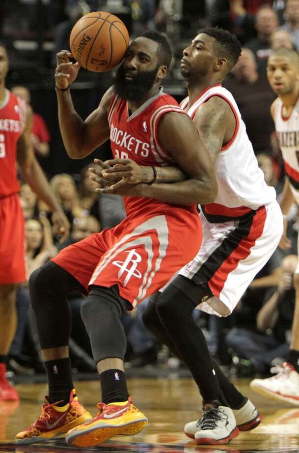 Houston Rockets guard James Harden (13) loses the handle on the ball while being defended by Portland Trail Blazers forward Dorell Wright, right, during the fourth quarter of Game 4 of the Western Conference Quarterfinals playoffs at the Moda Center Sunday, April 27, 2014, in Portland. ( James Nielsen / Houston Chronicle ) Photo: James Nielsen, Houston Chronicle
