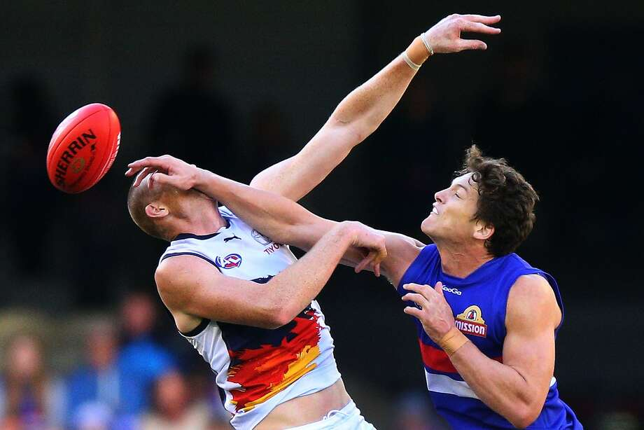MELBOURNE, AUSTRALIA - APRIL 27:  Will Minson (R) of the Bulldogs hits Sam Jacobs of the Crows in the face during a ruck contest during the round six AFL match between the Western Bulldogs and the Adelaide Crows at Etihad Stadium on April 27, 2014 in Melbourne, Australia.  (Photo by Michael Dodge/Getty Images) *** BESTPIX *** Photo: Michael Dodge, Getty Images