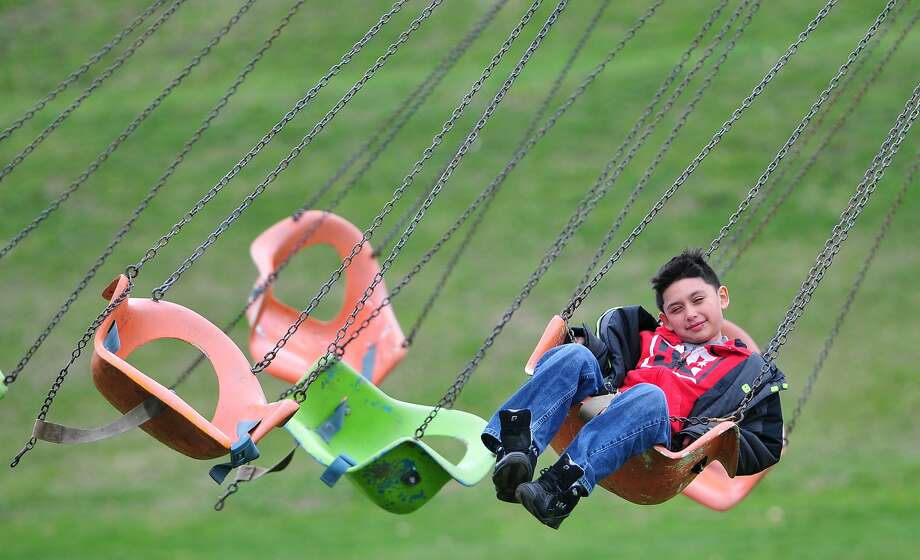 Michael Naved relaxes on a flying seat ride during the Cherry Blossom Festival in Wilkes-Barre, Pa, Sunday, April 27, 2014. (AP Photo/The Citizens' Voice, Andrew Krech)  MANDATORY CREDIT Photo: Andrew Krech, Associated Press
