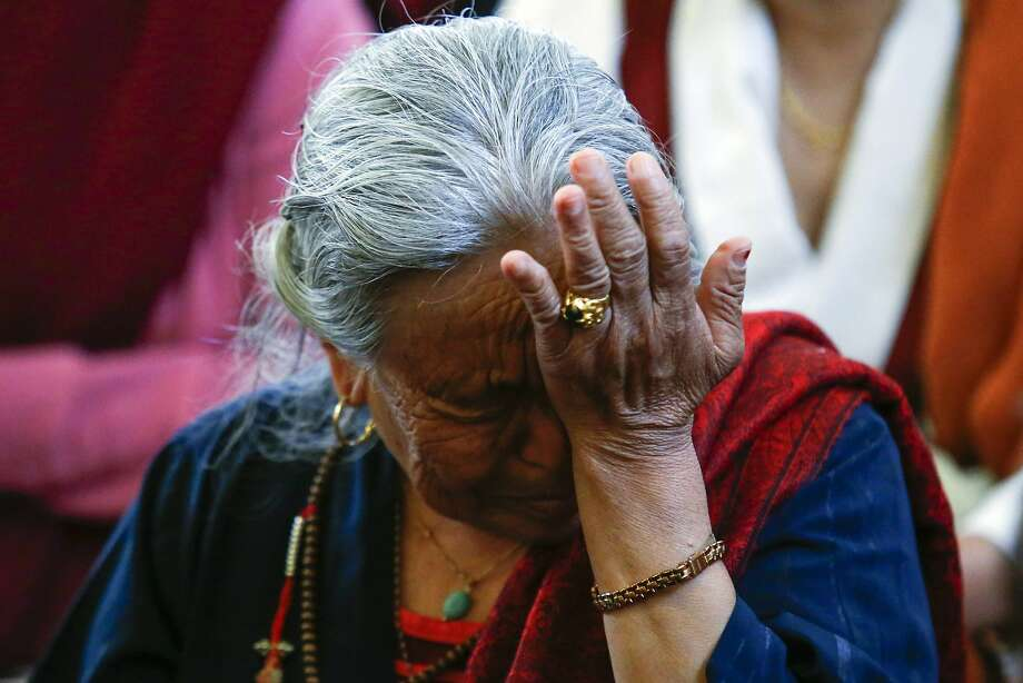 A member of United Sherpa Association cries while people take part in a prayer service for those killed in Mount Everest avalanche, in Queens, New York, April 27, 2014. REUTERS/Eduardo Munoz (UNITED STATES - Tags: TRAVEL SOCIETY DISASTER) Photo: Eduardo Munoz, Reuters