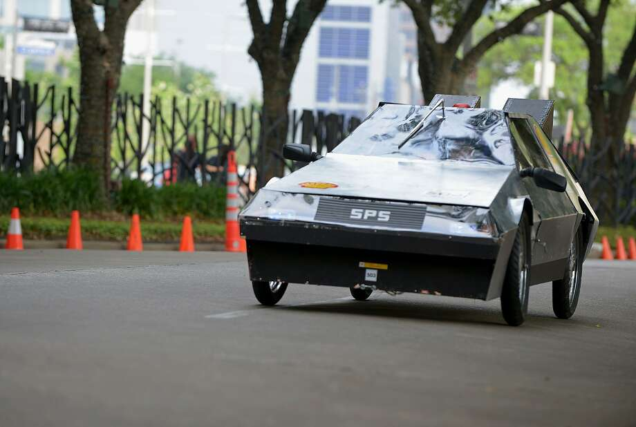 IMAGE DISTRIBUTED FOR SHELL - The Delorean 2.0, #503, UrbanConcept, running on Gasoline, competing for team Back to the Future Part ll from St. Pauls High School, Louisiana, United States, makes it's way around the track during day 4 of the Shell Eco-marathon Americas 2014, Sunday, April 27, 2014, at the George R. Brown Convention Center in Houston. (Jack Thompson/AP Images for Shell) Photo: Jack Thompson, Associated Press