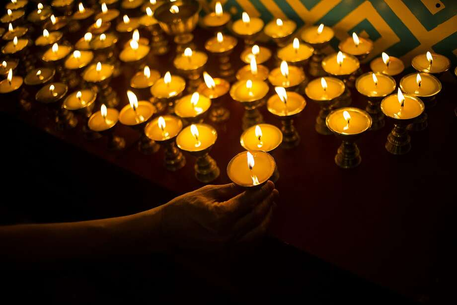 NEW YORK, NY - APRIL 27:  Candles are shown during a prayer service at the United Sherpa Association monastery April 27, 2014 in the Elmhurst neighborhood of the Queens borough of New York. The day-long service was held for victims of the April 18 avalanche on Mt. Everest in Himalayas that claimed the lives of 16 Sherpas.  (Photo by Eric Thayer/Getty Images) Photo: Eric Thayer, Getty Images