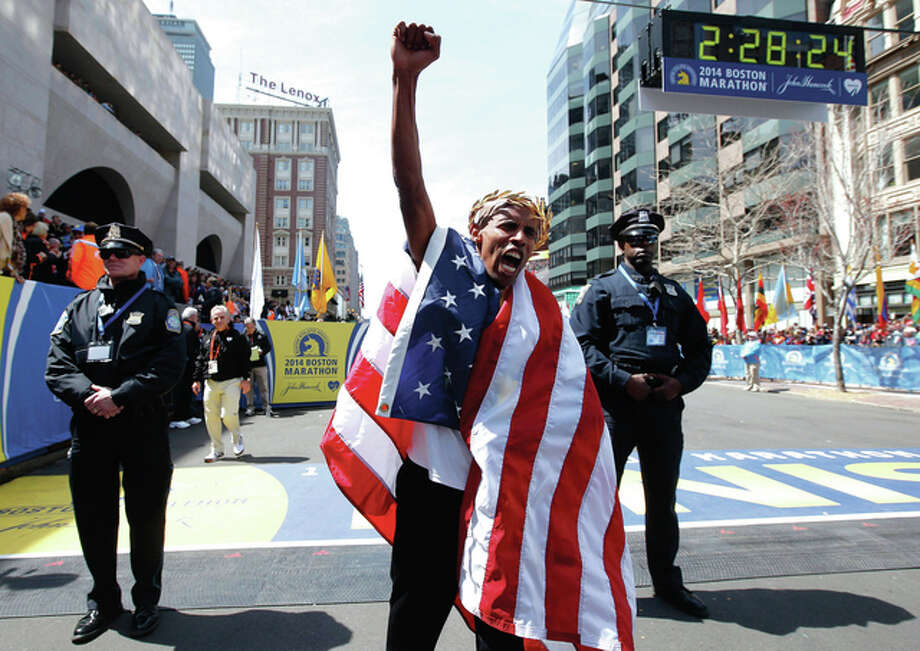 Meb Keflezighi of San Diego was the first American man to win the Boston Marathon since 1983. Photo: Associated Press / Fairfield Citizen