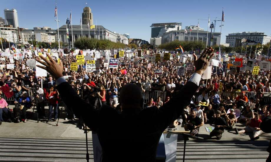 Gather with thousands at San Francisco City Hall for a special occasion or rally. Pictured: The Rev. Amos Brown ignites a crowd with a fiery speech at a rally denouncing the passage of Prop. 8. Photo: Paul Chinn, The Chronicle