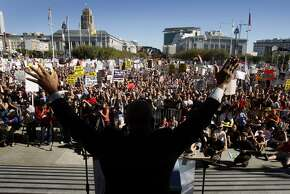 Gather with thousands at San Francisco City Hall for a special occasion or rally. Pictured: The Rev. Amos Brown ignites a crowd with a fiery speech at a rally denouncing the passage of Prop. 8.