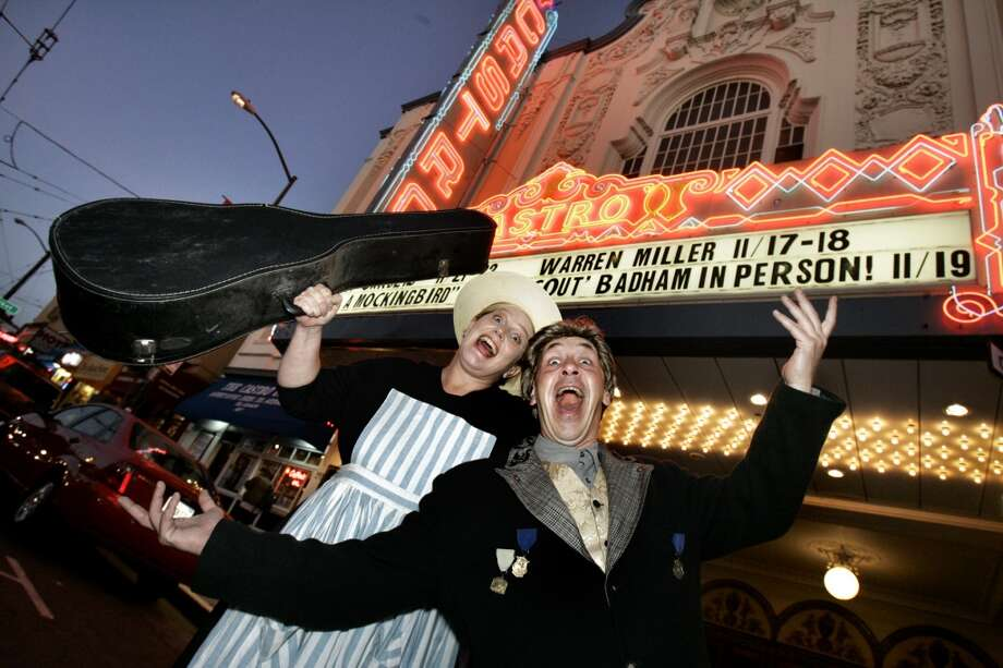 Lose your voice at  a Castro Theatre sing along. Pictured: Laurie Bushman, (left) and  Joe Collins are a warm-up duo who help the audience get in the mood to sing. Photo: Katy Raddatz, The Chronicle