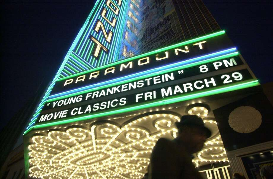 Watch a classic movie at the Paramount Theater in Oakland. Photo: CHRISTINA KOCI HERNANDEZ, SFC