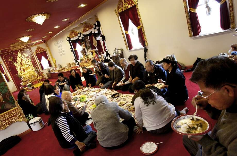 Have a Berkeley meal prepared by monks. Pictured: A large group of people dine inside the Thai temple. Some religious institutions serve food on a regular basis, including Buddhist temple Wat Mongkolratanaram. Photo: Brant Ward, The Chronicle