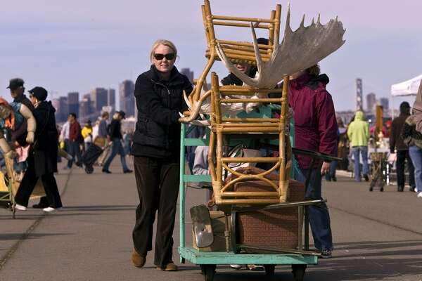 Explore the Alemany Flea Market in San Francisco on a Sunday, or, if you're a serious shopper and collector, head to the Alameda Point Antiques Faire instead. Pictured: Sasha Mock of Sausalito pushes her cart of recent purchases at the Alameda Antiques Faire.