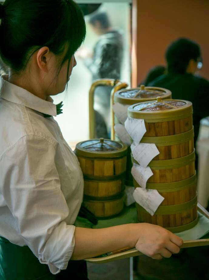 A server brings Dim Sum to tables at Hong Kong Lounge 2 in San Francisco. Photo: John Storey, Special To The Chronicle