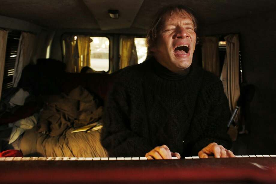 Once a contributing musician in the band Silver Jews, Chris Stroffolino plays a song in his Piano Van parked at the Safeway on Mission Street in San Francisco. Photo: Mike Kepka, The Chronicle