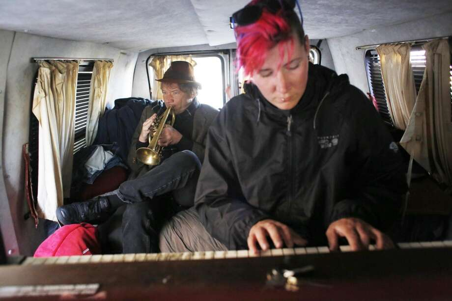 M.K. Caldwell and Chris Stroffolino collaborate on a cover tune in the Piano Van on Mission Street in San Francisco. Photo: Mike Kepka, The Chronicle