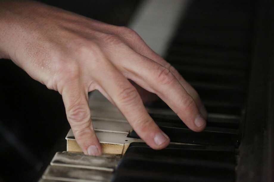 Chris Stroffolino plays plays the well worn keys of the piano that is bolted to the floor or his van in San Francisco. Photo: Mike Kepka, The Chronicle