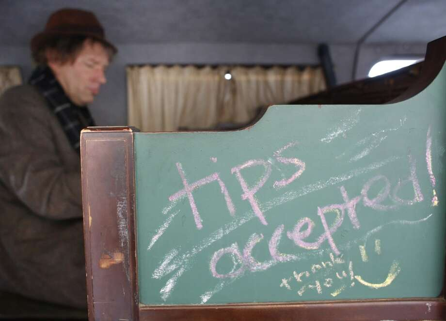 Tips are always accepted when Chris Stroffolino plays in his Piano Van. Photo: Mike Kepka, The Chronicle