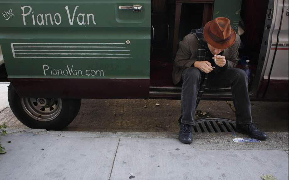 Chris Stroffolino takes a cigarette break while parked on Mission Street in San Francisco. Photo: Mike Kepka, The Chronicle