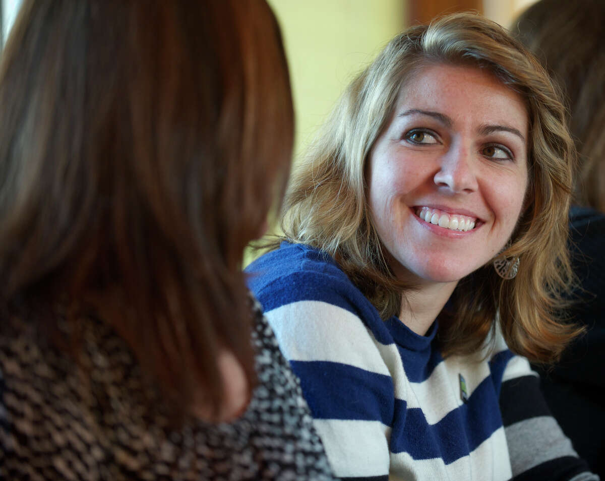 Monique Gesualdi, 28, of Danbury, Conn, has undergone a liver transplant and two brain surgeries and has had an amazing recovery. Her family is instrumental in her recovery and Sunday afternoon dinner at her grandparents house in Danbury, has been a large part of that. Sunday, April 27, 2014.
