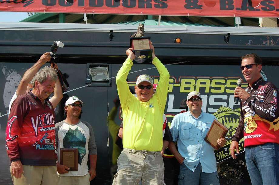 Bob Sealy and 4 time Bassmaster Classic Champion Kevin Van Dam present the trophy to Robert Nunley this  years winner. Photo by Patty Lenderman