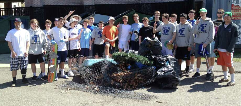 MAKING A CLEAN SWEEP When it came to tackling a community-service project during spring break, Fairfield Ludlowe High School's freshman lacrosse team's attitude was hardly lax. The team last weekend cleaned litter from the rear of the school's student parking lot and gathered debris left on adjacent Sturges Hill by winter sledders. Standing before the trash they collected, some of the players seem to be signalling they're No. 1 as  grounds keepers. Photo: Fairfield Citizen/Contributed / Fairfield Citizen