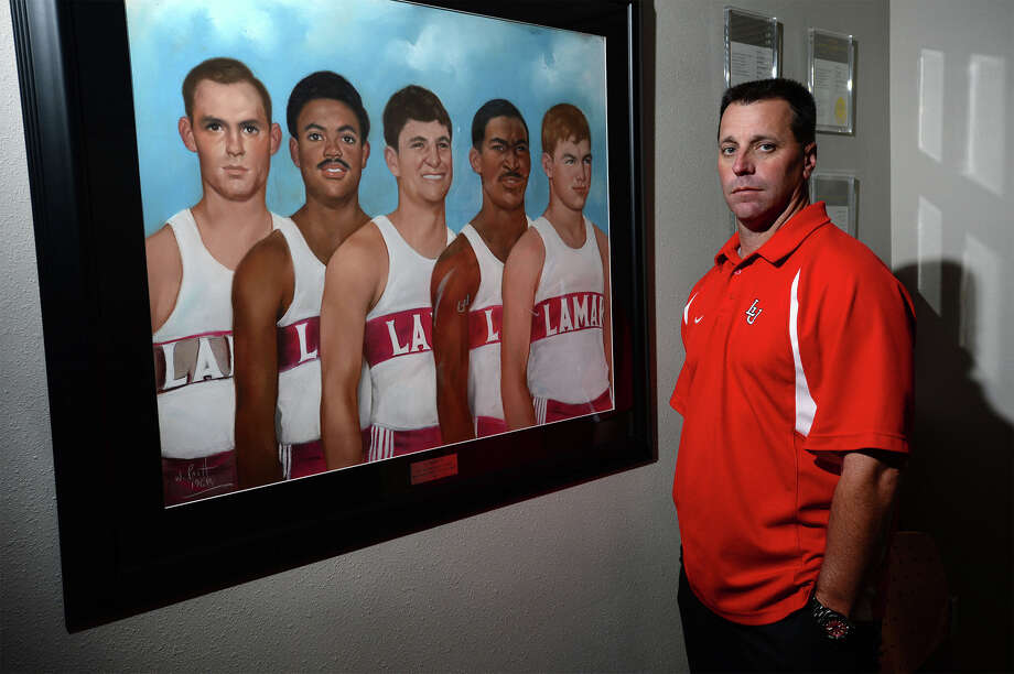 Trey Clark stands next to a drawing of, from left John Richardson, Waverly Thomas, Mike Favazza, Randy Clewis and Don Delaune. The five Lamar track runners and their coach Ty Terrell died in a plane crash returning home from a competition in 1968. Photo taken Wednesday, April 23, 2014  Guiseppe Barranco/@spotnewsshooter Photo: Guiseppe Barranco, Photo Editor