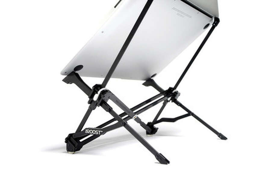 The portable Roost stand from www.therooststand.com raises a laptop to eye level. Photo: Roost