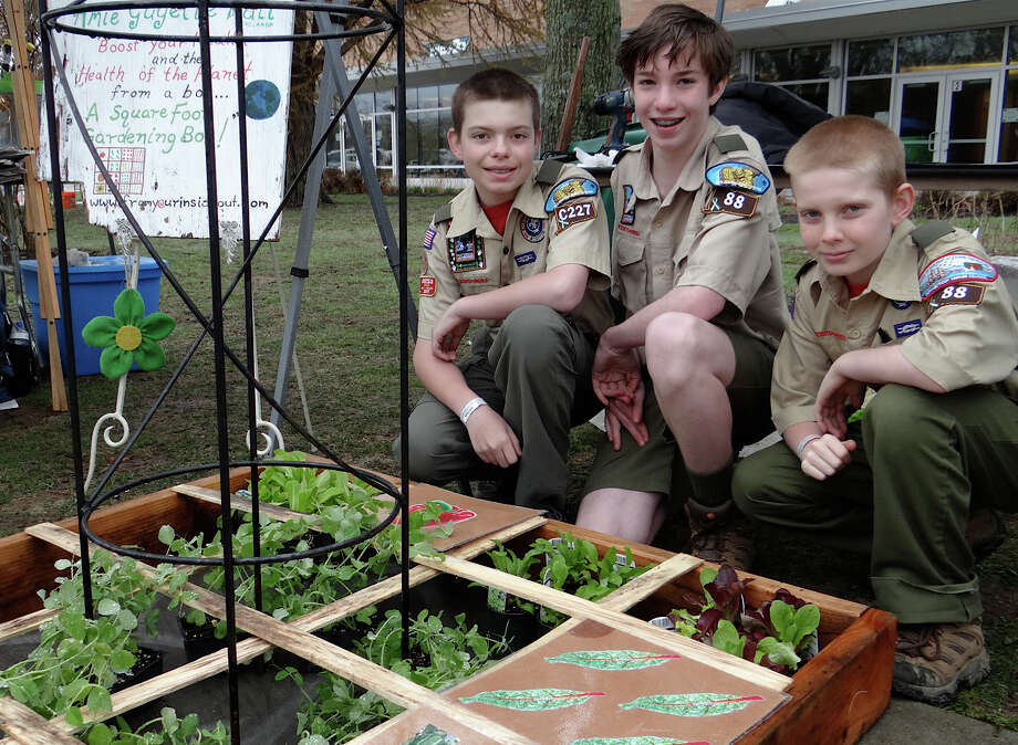 Troop 88 Boy Scouts Zachary Ratner, 13; Blake Cheney, 13, and Ben Ratner, 11, promote square-foot gardening at Fairfield's Earth Day Celebration at Fairfield Warde High School on Saturday. Photo: Mike Lauterborn / Fairfield Citizen