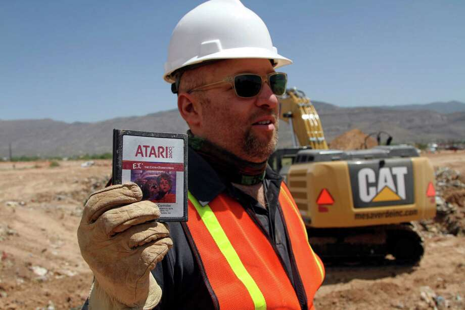 Film Director Zak Penn shows a box of a decades-old Atari 'E.T. the Extra-Terrestrial' game found in a dumpsite in Alamogordo, N.M., Saturday, April 26, 2014. Producers of a documentary dug in a southeastern New Mexico landfill in search of millions of cartridges of the game that has been called the worst game in the history of video gaming and were buried there in 1983. Photo: Juan Carlos Llorca, AP / AP
