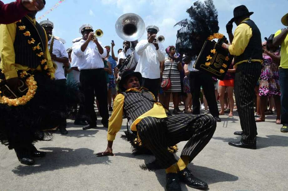 Second Line Parade featuring New Wave Brass Band and Nine Times Men and Single Ladies and Single Men Social Aid & Pleasure Clubs parade  Photo: Leon Morris, Getty / 2014 Leon Morris