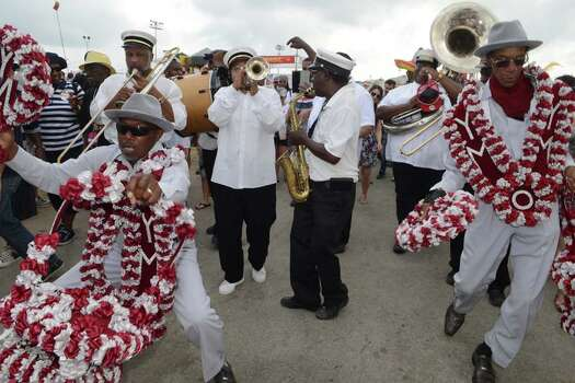Second line parade featuring Tornado Brass Band with Young Men Olympia Aid, New Look and and First Division Social Aid and Pleasure Clubs parading on the grounds of the New Orleans Jazz And Heritage Festival Photo: Leon Morris, Getty / 2014 Leon Morris